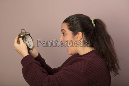 horrified woman looking at the time