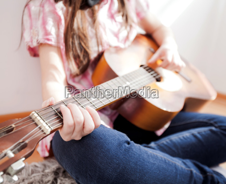 music woman play acoustic guitar