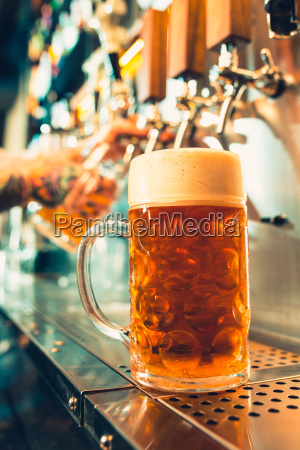 glass of beer with barrel bottle