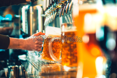 hand of bartender pouring a large