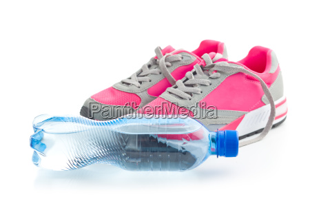 sports shoes and a bottle of