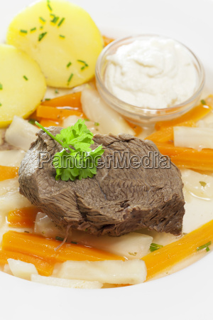 tafelspitz on a plate with vegetables
