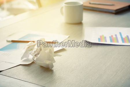 crumpled paper ball on the table