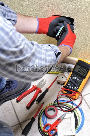 electrician technician at work with safety