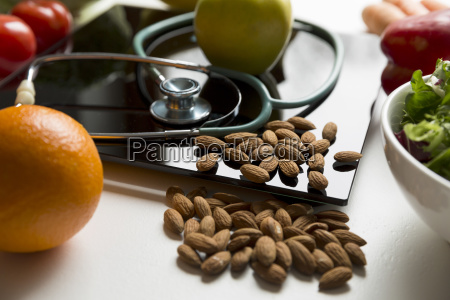 healthy fruit vegetables and stethoscope on