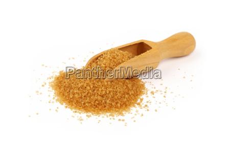 wooden scoop spoon full of brown
