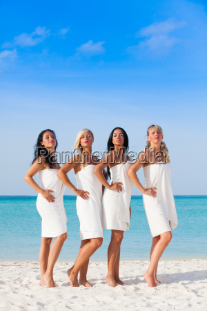 girls in white towels on a