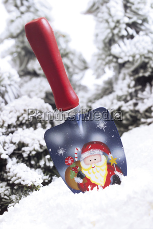 shovel with santa claus motive in