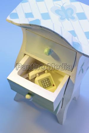 telephone phone inside indoor photo furniture