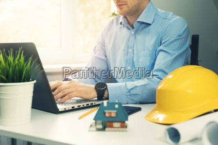 architect construction engineer working with laptop