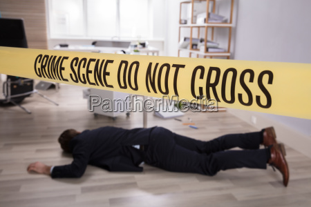 dead mans body lying on floor