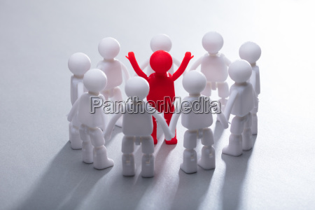 red human figure surrounded by team