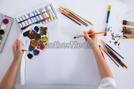 elevated view of artist painting on