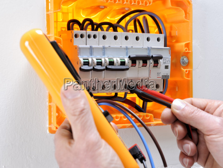 electrician technician at work on a