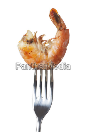 grilled shrimps on a fork on