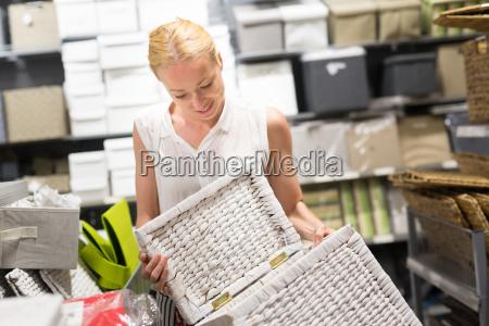 beautiful young woman shopping in retail