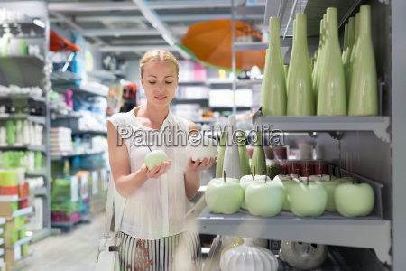 beautiful young woman shopping in retail