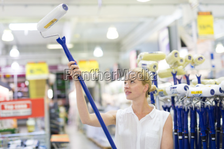 young independent woman buying tools for