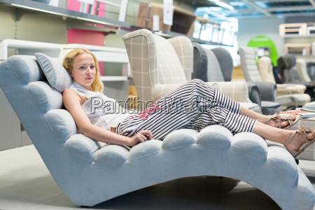 woman shopping for new sofa chair