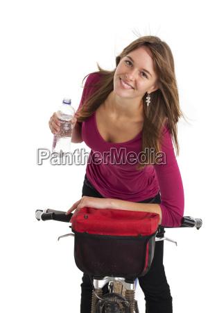 young woman by mountain bike