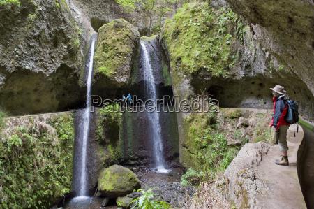 levada nova passes behind the waterfall