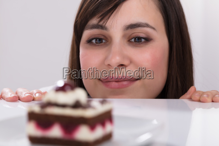 young woman looking at slice of