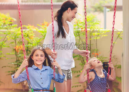 mother with two daughters on playground