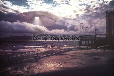 ufo arriving on beach vacation