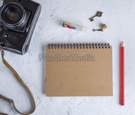 open blank notepad on an iron