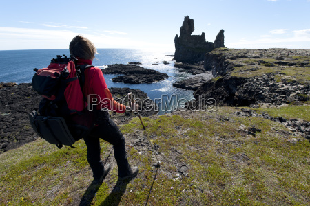 hiker at the londrangar rock formation
