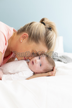 young beautiful and blond mother with