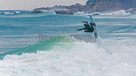 surfer jumping on the big