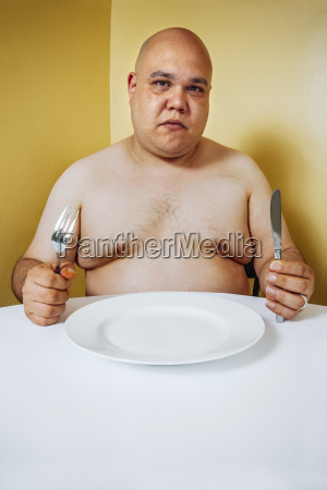 hungry fat man waiting for dinner