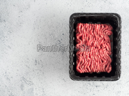 raw minced beef on light gray