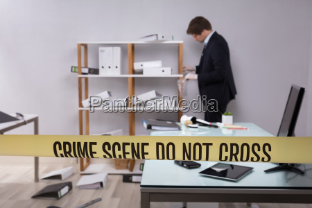 investigator collecting evidence in office
