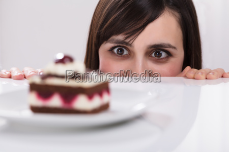 woman craving for slice of cake