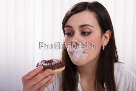 woman with sticky tape over her