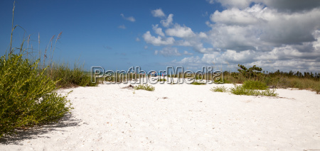 blue sky over white sand and