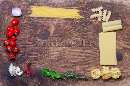 pasta frames and ingredients on wood