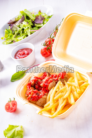 grilled bratwurst with french fries and