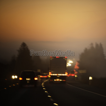 rear view of traffic at twilight