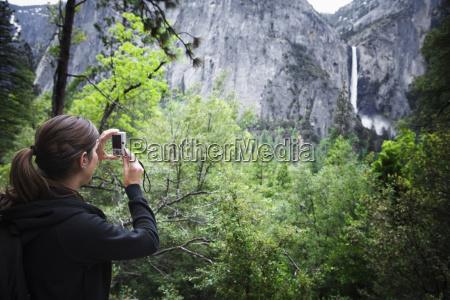 a female hiker taking a photograph