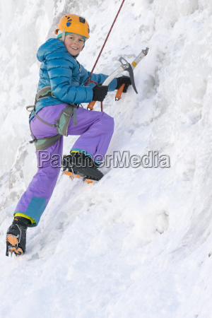 portrait of young girl ice climbing