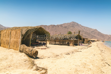 straw huts for accommodation on beach