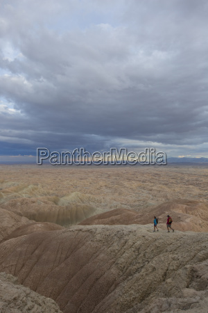 adult couple hiking in badlands section