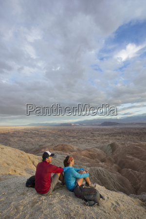 couple sitting together in badlands section