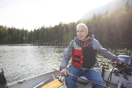 fisherman sitting in motorboat hicks lake