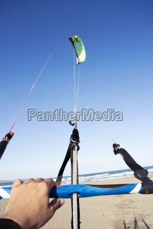 personal perspective of kitesurfer holding floating