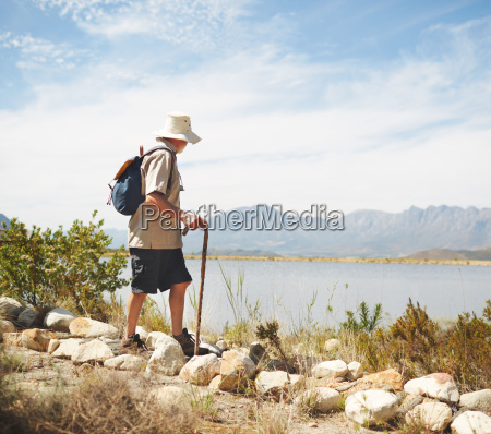 male hiker with backpack and walking