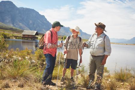 active senior men friends hiking along